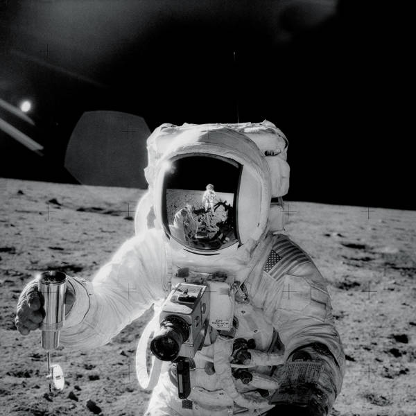 NASA - Astronaut Alan Bean Holds Sample Container